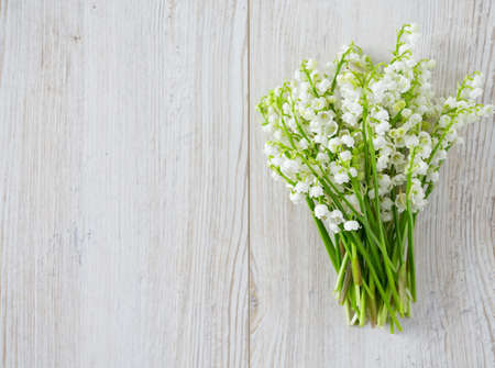 lily of the valley: lilies of the valley on the wooden surface
