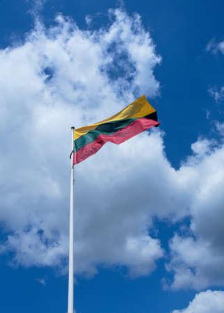 cloudy sky: Lithuanias flag over cloudy sky Stock Photo
