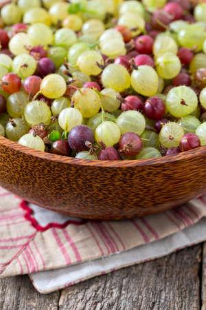 gooseberries: gooseberries on wooden surface Stock Photo