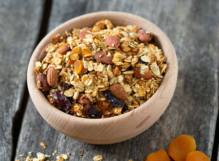 granola in wooden bowl Stock Photo
