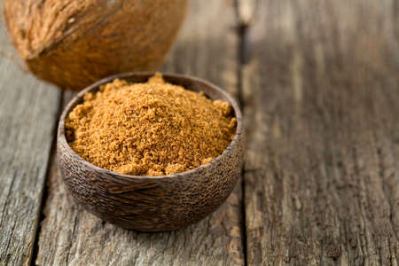 coconut palm sugar: coconut palm sugar on wooden surface Stock Photo
