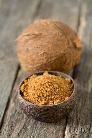 coconut palm sugar on wooden surface Stock Photo