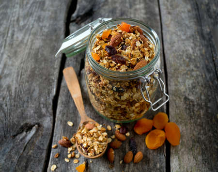 granola in glass jar on wooden table