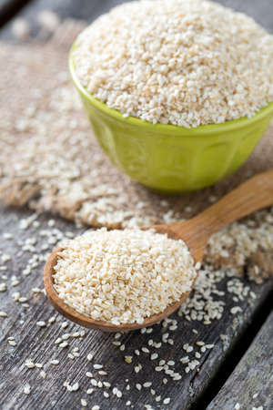 sesame seeds on wooden surface