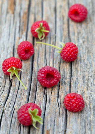 raspberry on wooden surface Stock Photo
