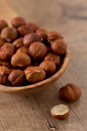 hazelnuts on wooden surface Stock Photo