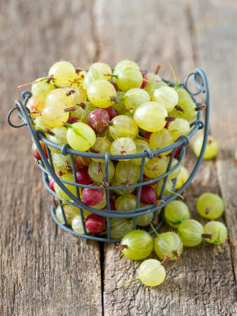 ribes: gooseberries on wooden surface Stock Photo
