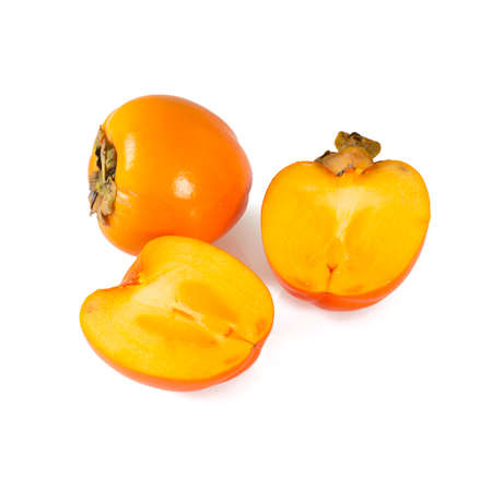 cut persimmon isolated on white