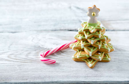 Gingerbread tree on white wooden surface Stock Photo