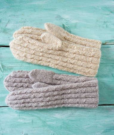braids: hand knitted mittens with braids Stock Photo