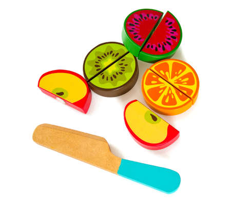 wooden toy fruits and knife Stock Photo