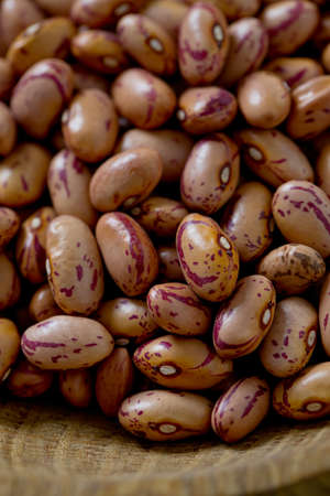 borlotti beans: pinto beans on wooden surface