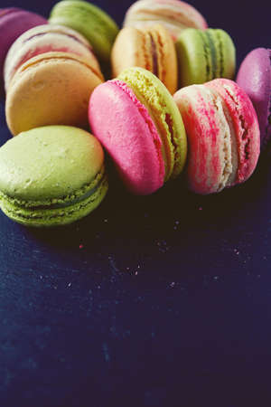 assorted macaroons on black chalkboard Stock Photo