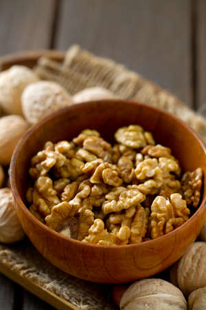 nutshells: walnuts on wooden surface