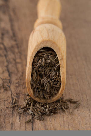 caraway in wooden surface