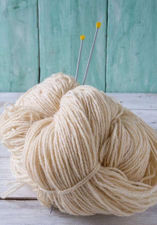crimson colour: knitting yarn hanks on wooden surface
