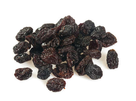 black raisins isolated on white