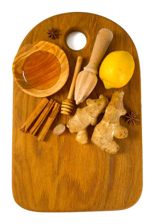 cerulean: honey, lemon and ginger on wooden cutting board Stock Photo