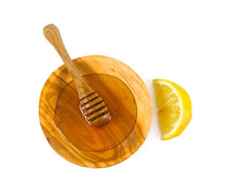drizzler: fresh honey and slice of lemon Stock Photo