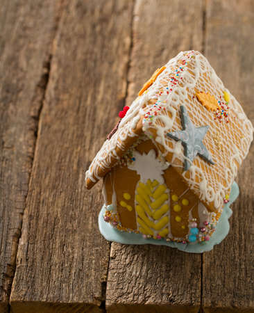 gingerbread house on wooden surface