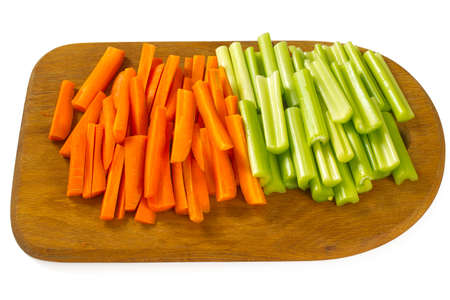 carrot and celery sticks isolated on white