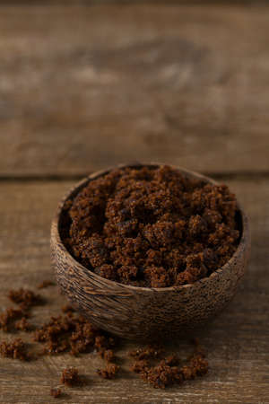 molasses sugar on wooden surface