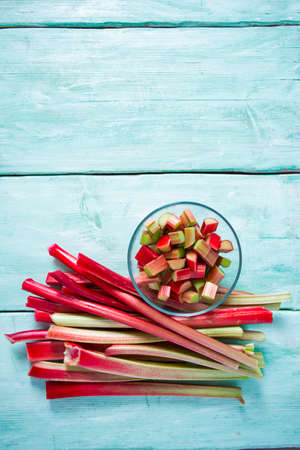 rhubarb stems on wooden surface