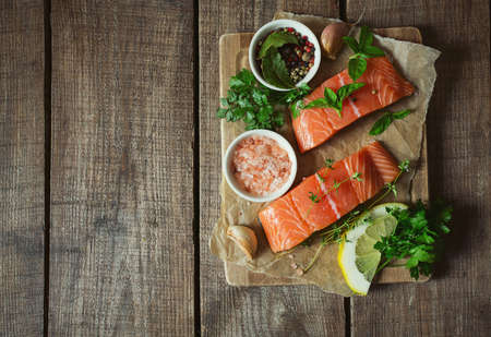 fresh salmon fillet on brown wooden surface
