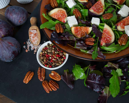 Figs, feta, rucola and pecan nut salad