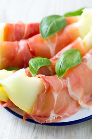 Melon and prosciutto with basil