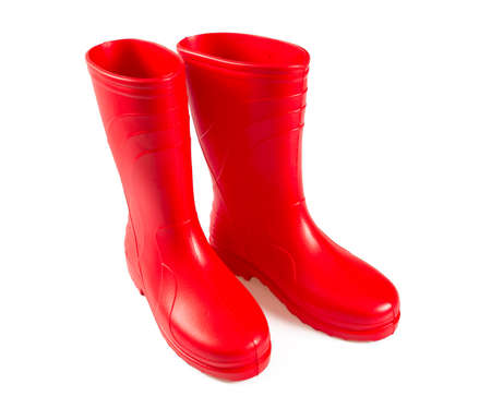 red rubber boots isolated on white Stock Photo