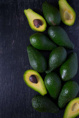 avocado on dark wooden surface