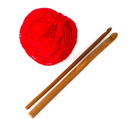 crochet hooks and red ball of yarn