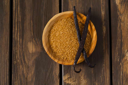 vanilla sugar in a wooden bowl Imagens