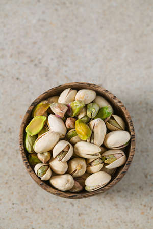 pistachio nuts on granite surface