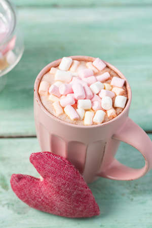 hot chocolate with marshmallows and a heart