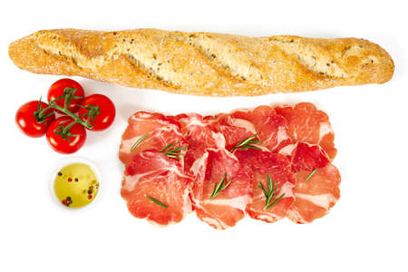 coppa di parma, cherry tomatoes and baguette isolated on white