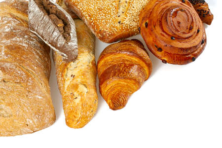 Composition with bread, rolls and wheat ears isolated on white background