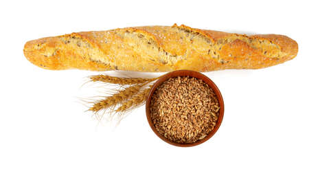 baguette with different seeds and grains isolated on white Stock Photo