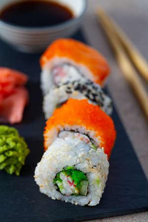 sushi rolls on black stone plate Standard-Bild - 123556446