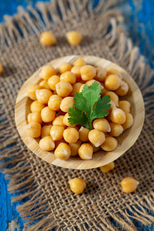 chickpea on blue wooden surface Stock Photo
