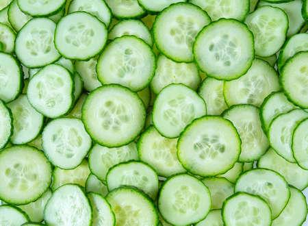 cut cucumbers isolated on white Standard-Bild - 124532098