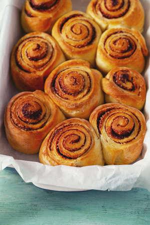 cinnamon rolls on wooden surface Standard-Bild - 124532100