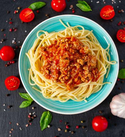 spaghetti bolognese on wooden surface Standard-Bild - 124532103