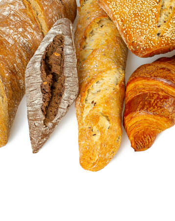 Composition with bread, rolls and wheat ears isolated on white background Standard-Bild - 124532140