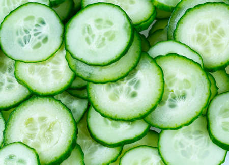 cut cucumbers isolated on white Standard-Bild - 124532267