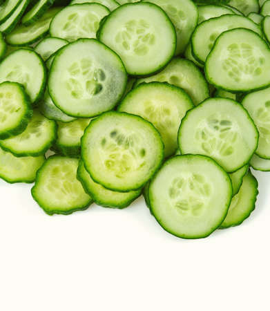 cut cucumbers isolated on white Standard-Bild - 124532268
