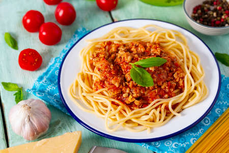 spaghetti bolognese on wooden surface Standard-Bild - 124532304