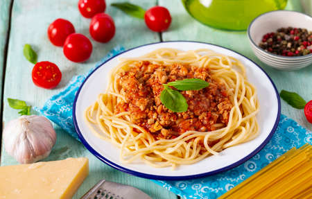 spaghetti bolognese on wooden surface Standard-Bild - 124532441