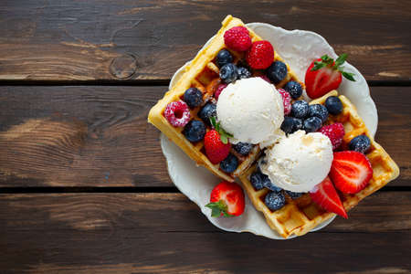belgian waffles with ice cream and berries Stock Photo